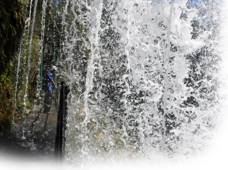 Man in Waterfalls ~ Photo by Patrice