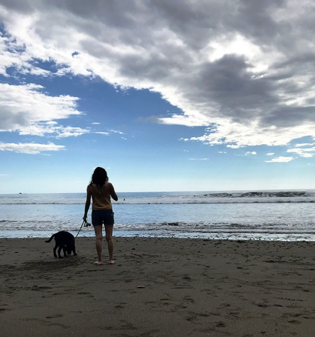 Girl and Dog at the Beach ~ Photo by Patrice
